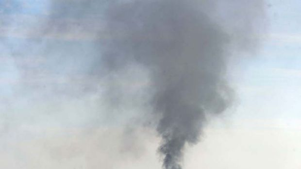 Smoke rises from the Syrian northwestern city of Saraqib, near Idlib, where forces blitzed opposition hubs.