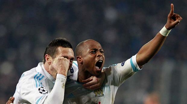 Olympic Marseille's Andre Ayew celebrates after scoring against Inter Milan.