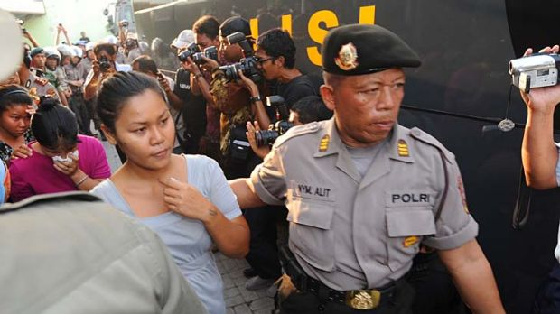 Evacuatred ... female inmates are escorted out of Kerobokan prison after two days of rioting.