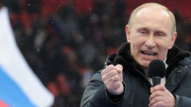 Boisterous ... Vladmir Putin addresses a crowd of 130,000 at Luzhniki Stadium in Moscow. Mr Putin has cast the ...
