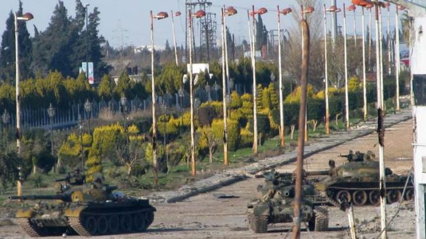 Syrian army tanks stationed at the entrance to Baba Amr neighbourhood in Homs.