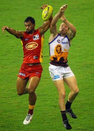 Hands up: Karmichael Hunt and Ryan Harwood in action.