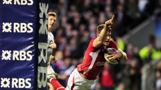 Crown clincher ... Scott Williams scores the match-winning try for Wales.