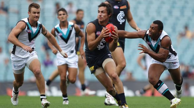 Kane is able: Carlton's Kane Lucas eludes Port's David Rodan.