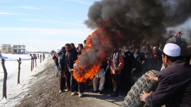 Afghans burn tyres during an anti-American demonstration over the burning of the Koran at a US military base south of Kabul.