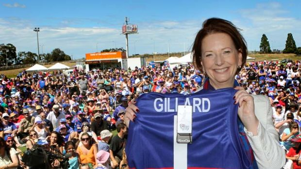Joint No. 1 ticket holder Julia Gillard shows off the Western Bulldogs jumper she received at Whitten Oval, where she ...