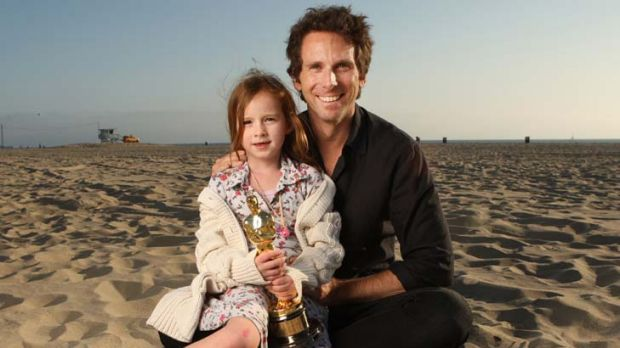 Life's a beach … Kirk Baxter and his daughter Bronte at Santa Monica with his Oscar for The Social Network. He has ...