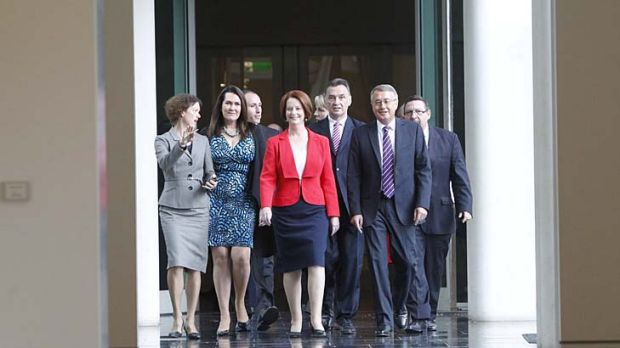 Julia Gillard, shown here with her supporters, has retained the prime ministership.