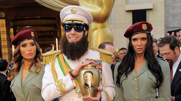"Storming the red carpet ... Sacha Baron Cohen at the Academy Awards with bodyguards and an urn with ""Kim Jong Il's ashes""."
