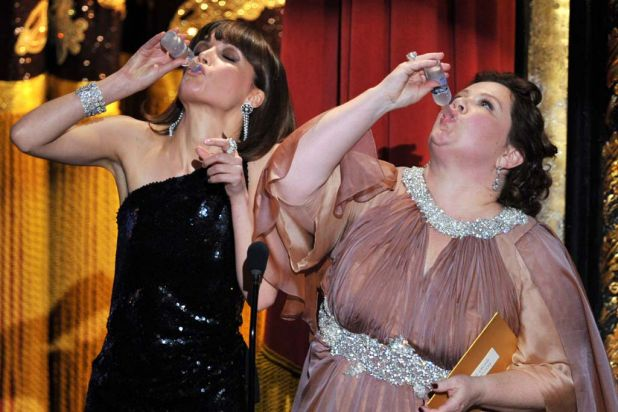 <i>Bridesmaids</i> co-stars Rose Byrne and Melissa McCarthy ham it up onstage.