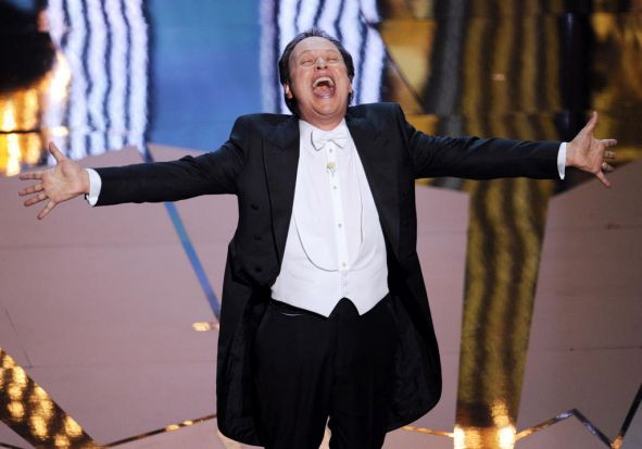 Host Billy Crystal launches into song to open the Academy Awards ceremony for 2012.