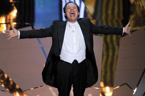Host Billy Crystal performs onstage.