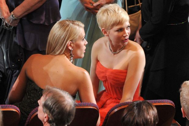 Actresses Busy Philipps (L) and Michelle Williams attend the 84th Annual Academy Awards.