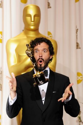Songwriter Bret McKenzie accepts the Best Original Song Award for 'Man or Muppet' from 'The Muppets,' poses in the press ...