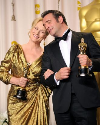 Actress Meryl Streep (L), winner of the Best Actress Award for 'The Iron Lady,' and actor Jean Dujardin, winner of the ...