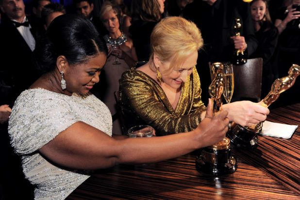 "Octavia Spencer with the Oscar for best actress in a supporting role for ""the Help"", left, and Meryl Streep with the ..."