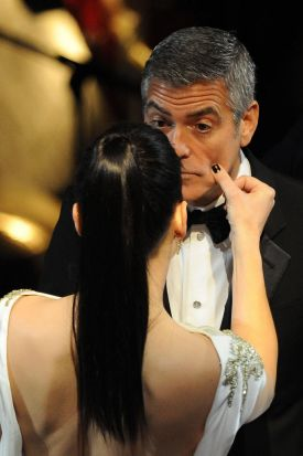 Actor George Clooney talks to actress Sandra Bullock prior to the ceremony.