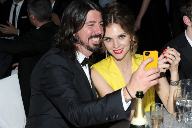 Musician Dave Grohl (L) and Jordyn Blum attend the 20th Annual Elton John AIDS Foundation Academy Awards Viewing Party.