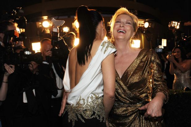 US actresses Meryl Streep (R) and Sandra Bullock laugh as they arrive at the Governor's Ball.