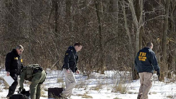 Fatal shooting ... FBI and local police investigators search for evidence.