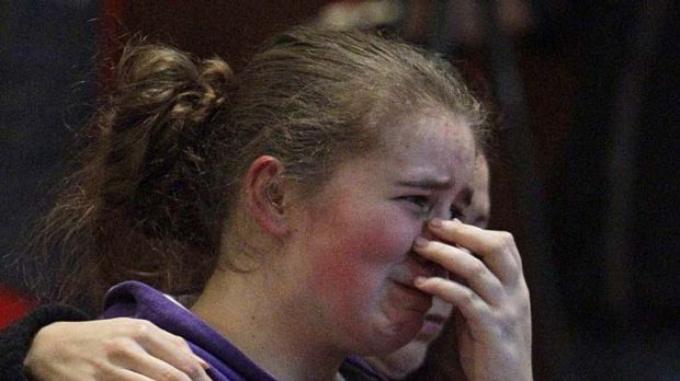 Alissa Sully, 17, cries during a prayer service for victims of the shooting.