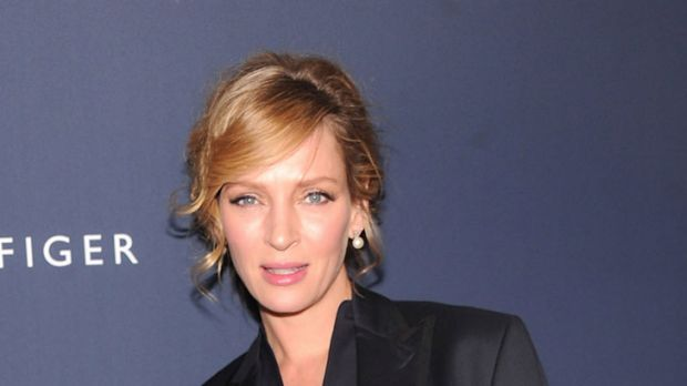 Maternity wear? ... Uma Thurman loosens up for the Tommy Hilfiger show.