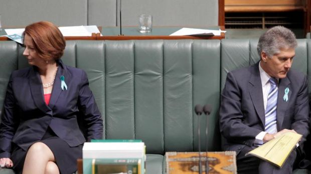 Prime Minister Julia Gillard sits next to defence minister Stephen Smith during a division in question time at ...