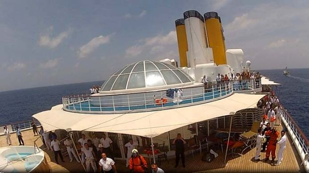 A still image taken from a video footage shows the Costa Allegra cruise ship being towed by French tuna boat Trevignon ...