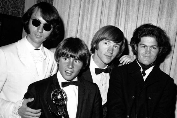 The Monkees posing with their 1967 Emmy award at the 19th Annual Primetime Emmy Awards.