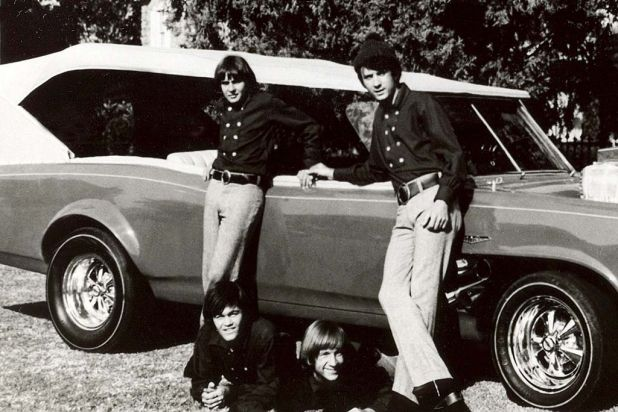 Cast members of the television show The Monkees, pose next to their customised Pontiac GTO, the Monkeemobile.