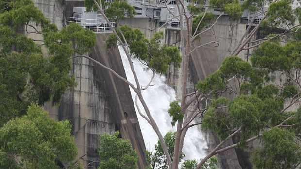 Water is released today from Warragamba Dam before it reaches capacity by midnight.