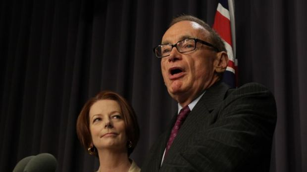 Prime Minister Julia Gillard watches on after announcing former NSW premier Bob Carr will become the new Foreign Affairs ...