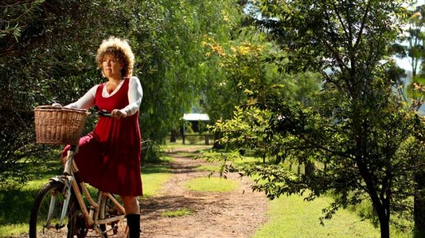 ''There was no victim in my particular Australian crime'' … a helmetless Sue Abbott with her bike on her Scone ...