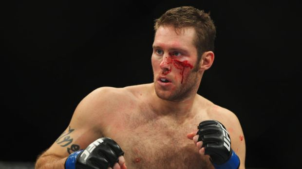 Nick Penner of Canada bleeds from a cut under his left eye.