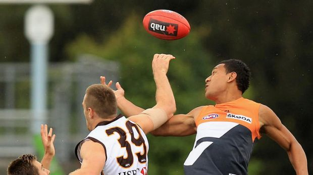 Flying high ... Israel Folau  of the Giants contests a ruck against Max Bailey.