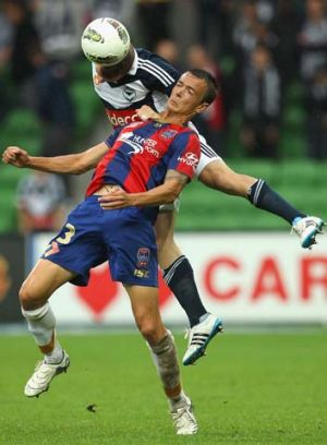 Leigh Broxham of Melbourne Victory is challenged by Ryan Griffiths of the Newcastle Jets during the round 22 A-League ...