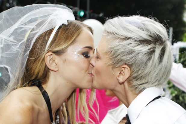 A lesbian couple kiss during the parade.