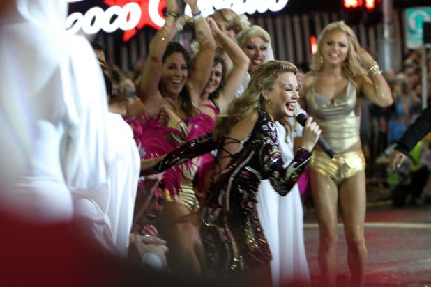 Kylie Minogue greets the dancers after watching a tribute performance in her honour in Taylor Square during the Mardi ...
