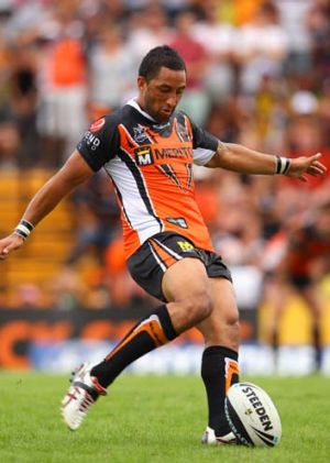Benji Marshall of the Tigers kicks the winning drop-goal in extra time.