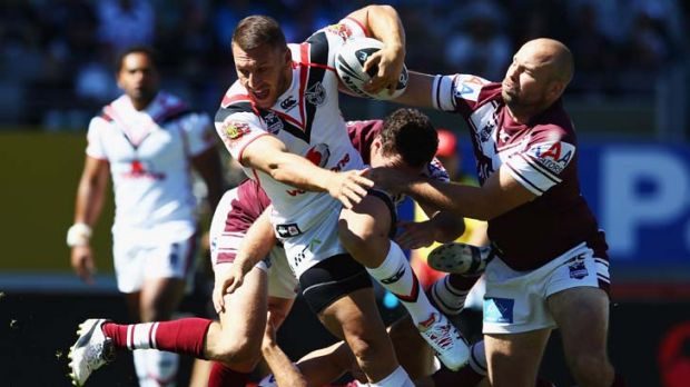 Making a break for it … Lewis Brown of the Warriors makes his escape from the Sea Eagles at Eden Park yesterday. ...