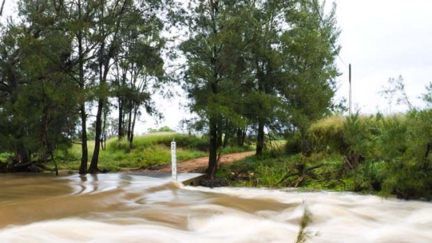 Floods blocking off a road just outside Coonabarabran, in central west NSW.