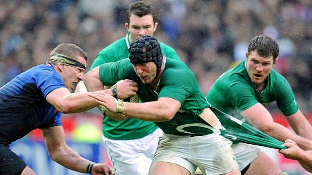 France's number 8 Imanol Harinordoquy  (left) tries to bring down Ireland's blind-side flanker Stephen Ferris.