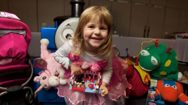 Charlotte Anderson, 3, holds the  Toy Of The Year – the Lego Friends City Park Cafe – at the Melbourne Convention and ...