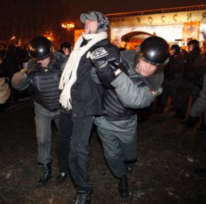 Riot police detain a protester during a demonstration in Moscow.