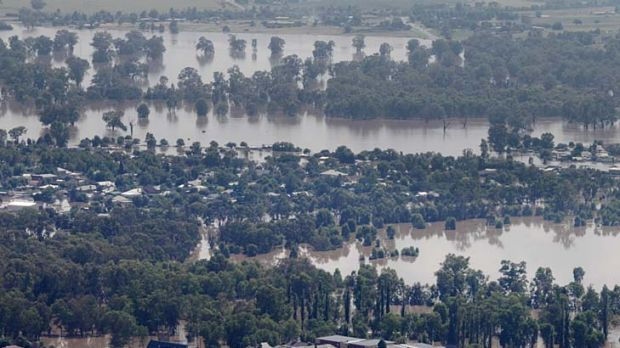 A levee holds flood waters from Wagga Wagga CBD in the foreground while North Wagga is inundated yesterday.
