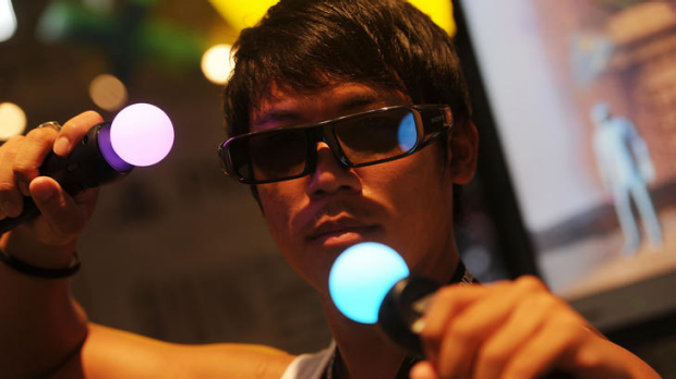 A computer gamers plays with a Sony 3D Playstation.