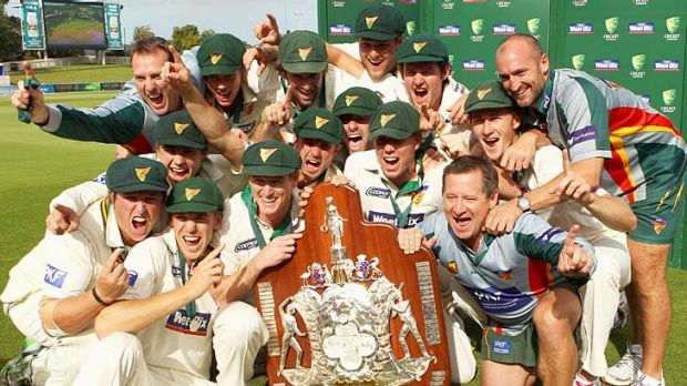 The Tasmanian Tigers team celebrate with the 2011 Sheffield Shield.