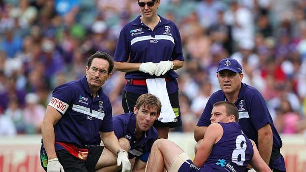 An all too familiar sight for Dockers fans in 2011 - Nick Suban having a broken leg attended to by trainers. Freo lost ...