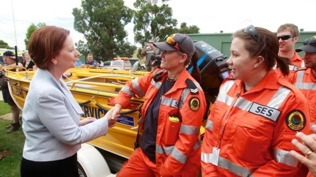 Prime Minister Julia Gillard met SES volunteers at the SES Wagga Wagga headquarters yesterday.
