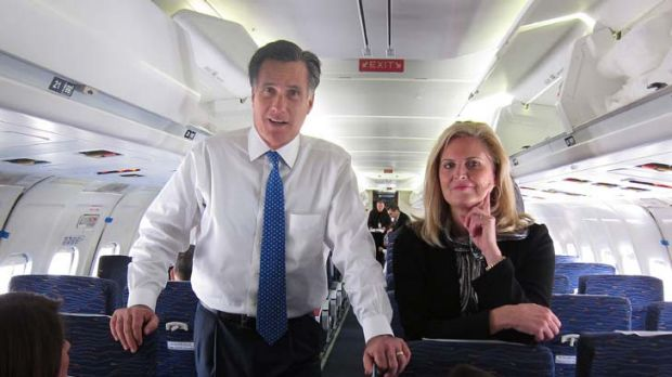 """A winner, with reservations ... Mr Romney, with his wife Ann behind him, speaks with reporters on the campaign plane in ..."